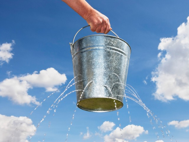 Man Holding Leaking Bucket